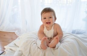 baby photography. smiling baby boy in photo studio. Backlit natural light studio