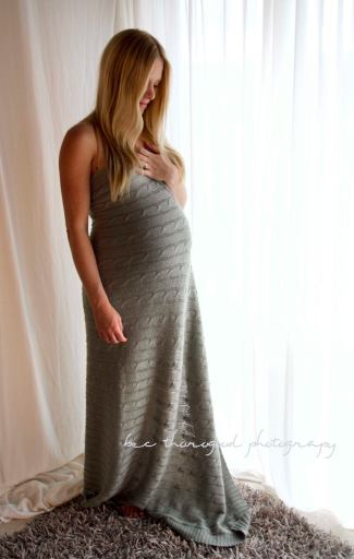 Maternity photograph. Backlit studio pregnancy shoot